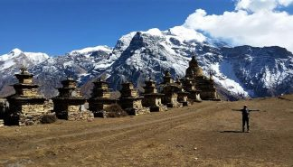 Landscape view of Kangaru Himal, shrines, and a stupa in Nar