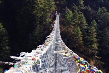 Namche bridge above the Dudh Koshi river and prayer flags